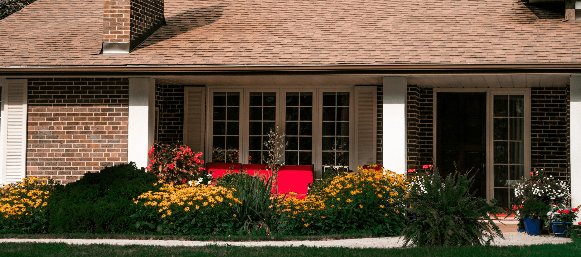 a suburban bungalow with a collection of flowers
