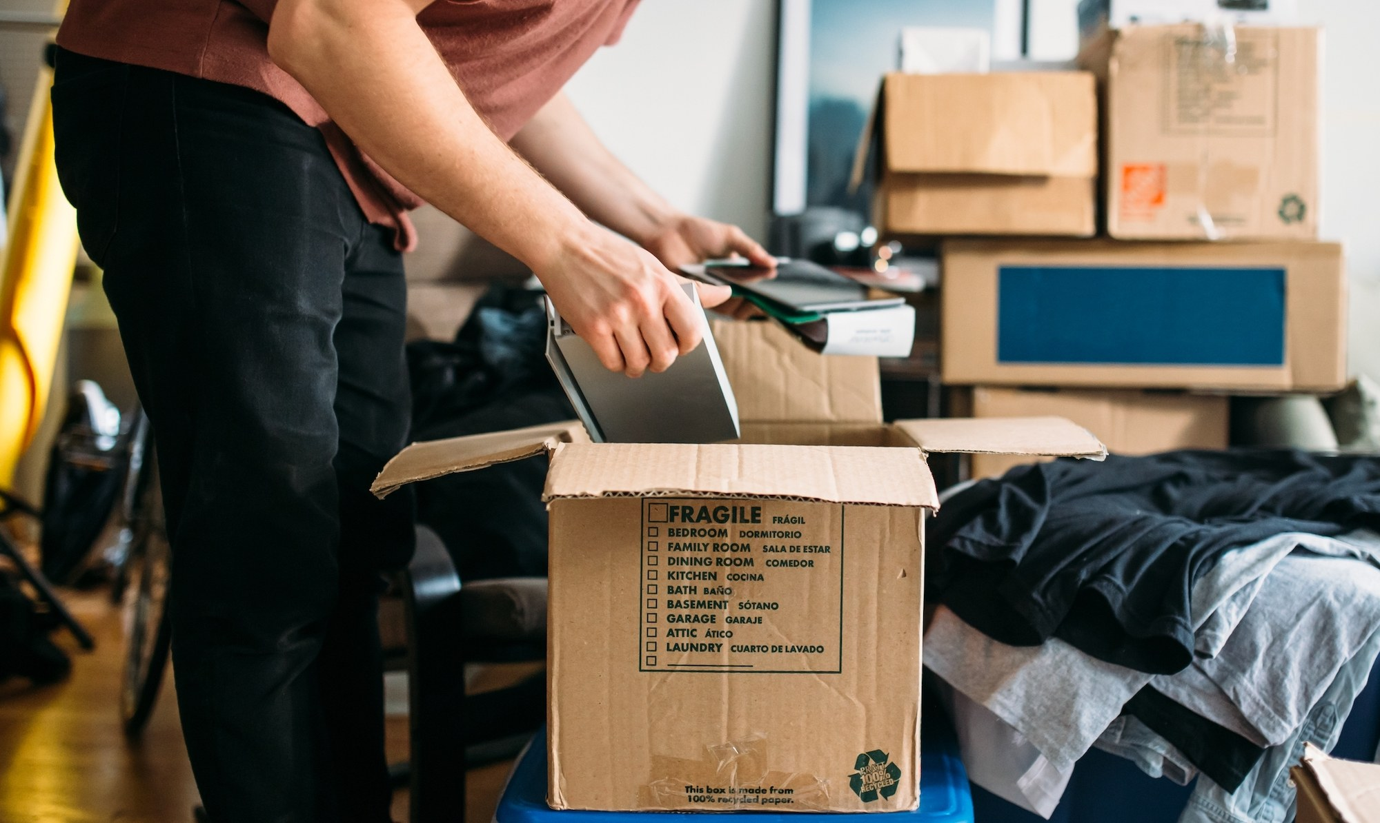 a person packs boxes to see if they can afford to move out