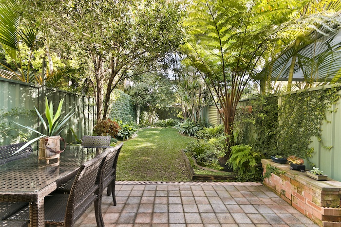 a picture of a backyard how to sell your house fast