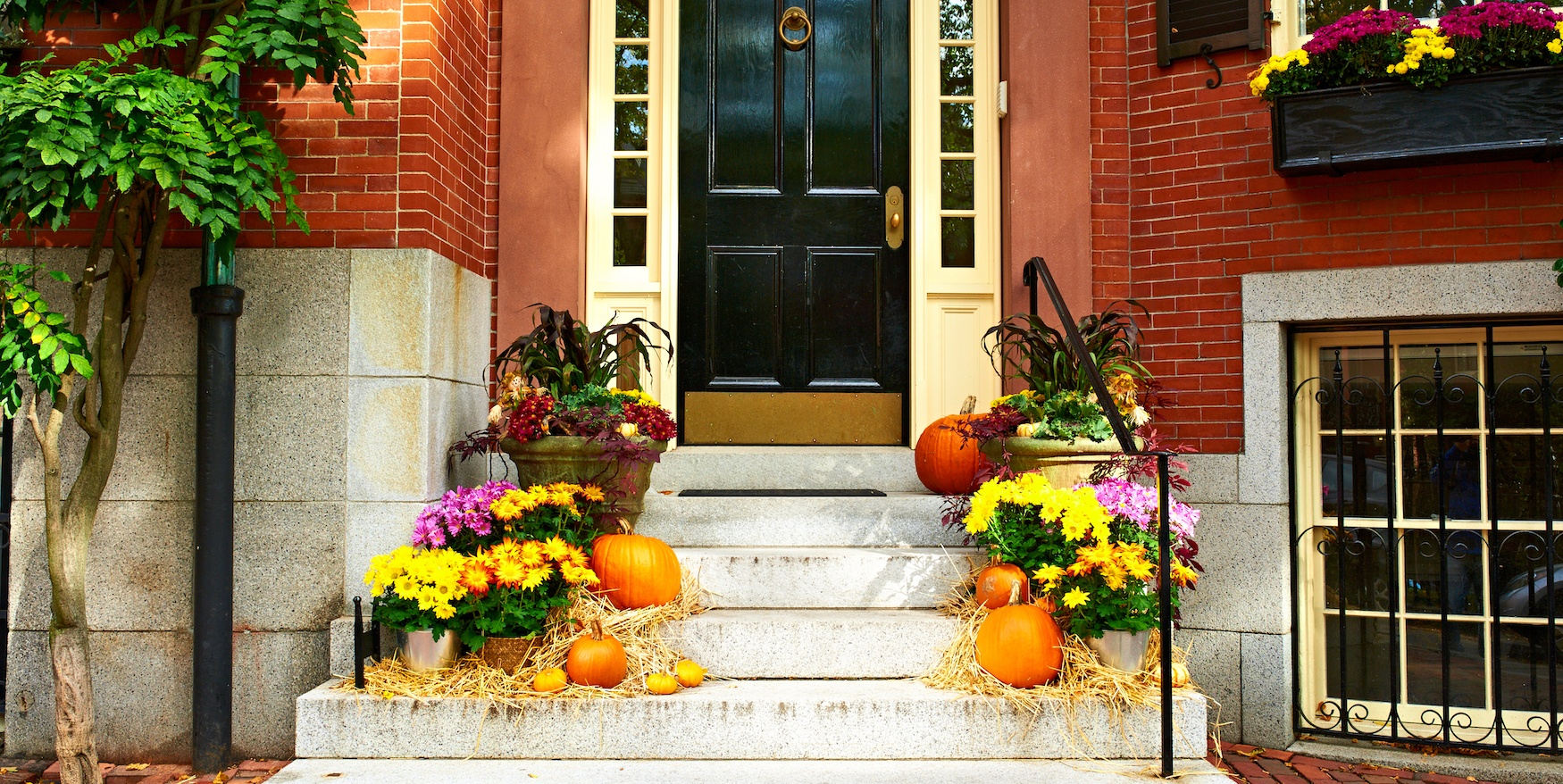 a photo of a house's front door decorations for halloween