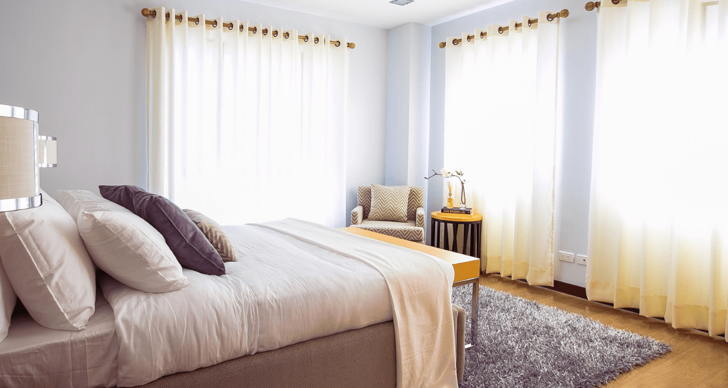 A bedroom that is staged when selling a home.
