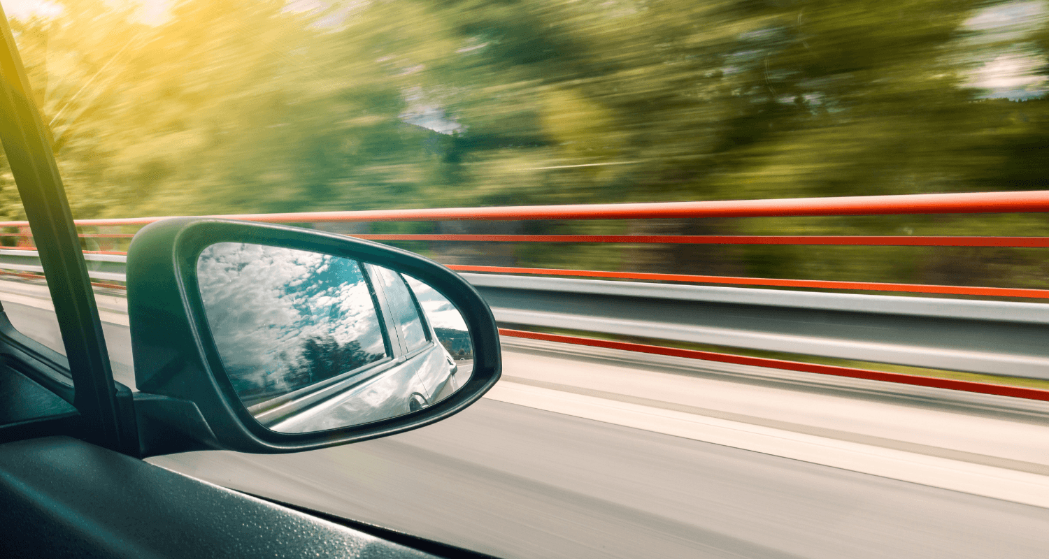 A rear view mirror showing the pros and cons of reverse mortgage.