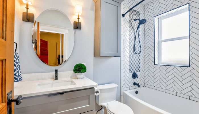 When staging your bathroom, make sure all the hardware finishes on your cabinets and drawers match.