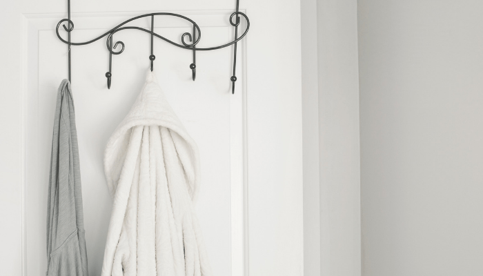 When staging your bathroom, drape a soft, luxury hotel-like bathrobe over the tub or door.