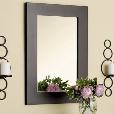 Stage your bathroom using a budget-friendly statement mirror.