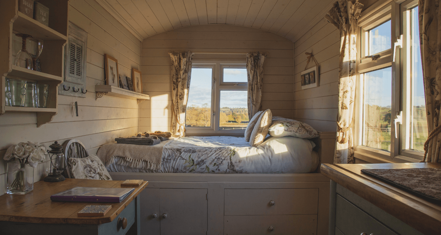 A bedroom in a tiny house.