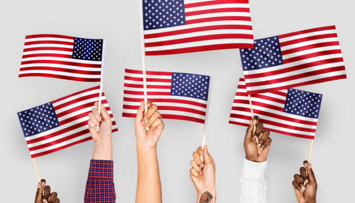 People holding flags on July Fourth.