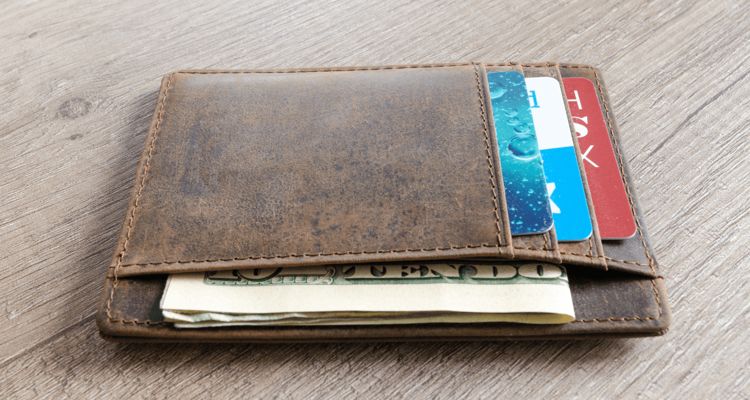 A wallet with credit cards that need to be used to pay off debt.
