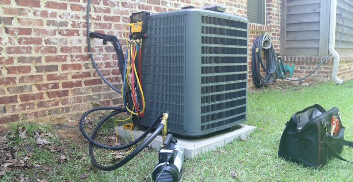 An air conditioner that is maintained outside of a home.