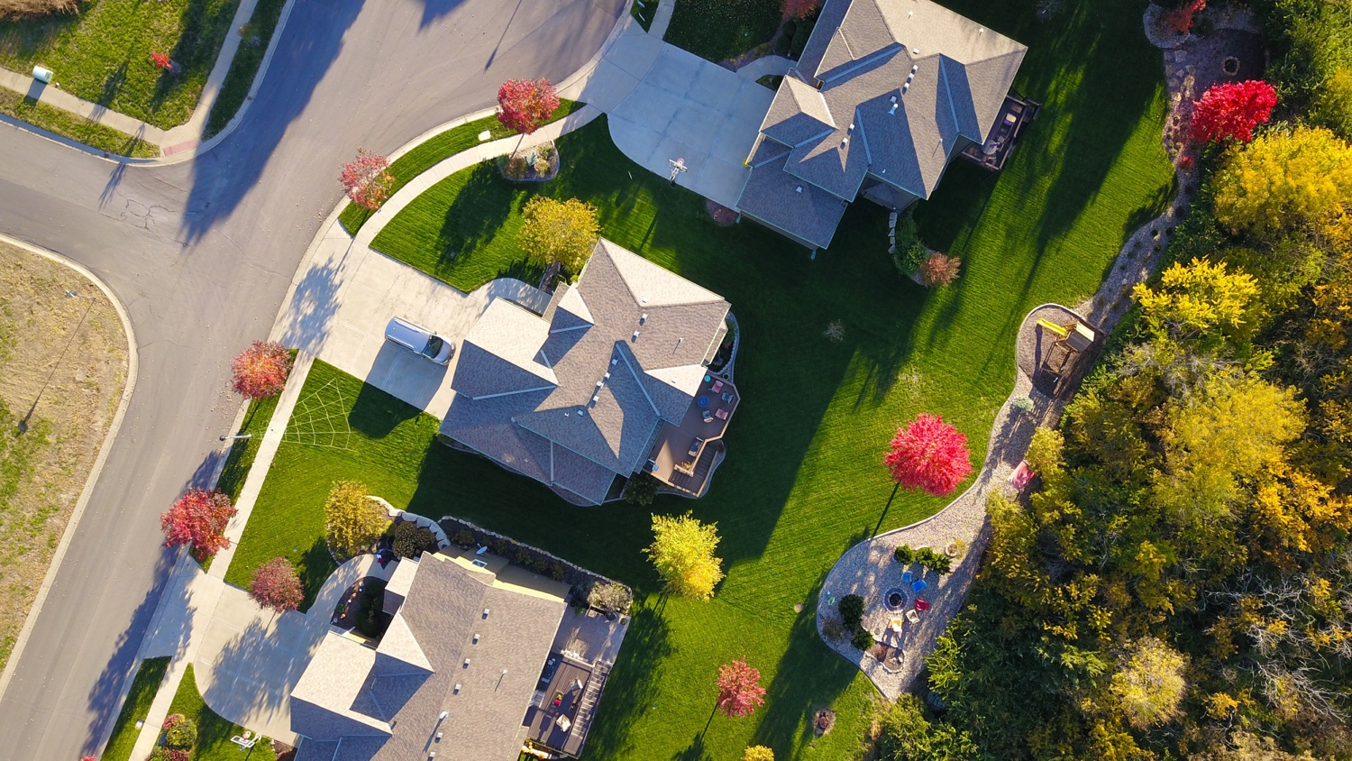 An aerial view of a home that is being maintained.