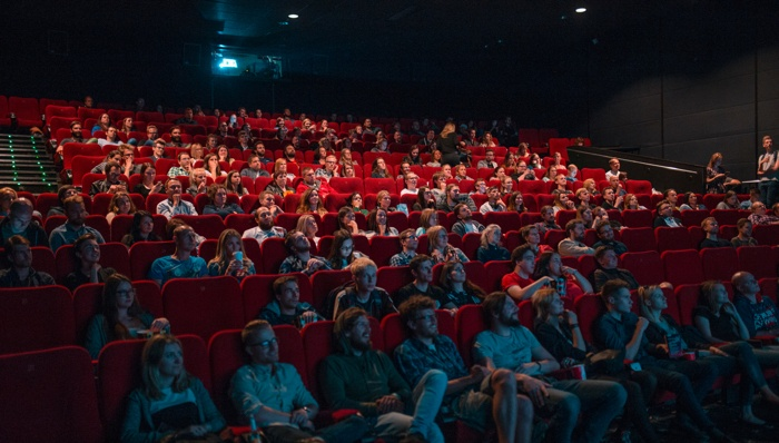 A movie theater with people in retirement.