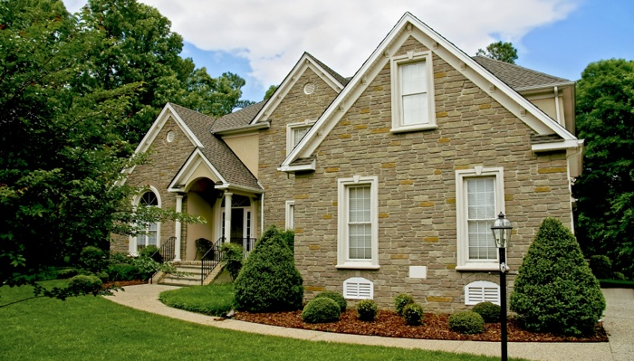 House with stone siding that has increased value.
