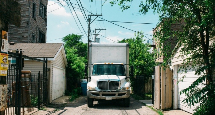 A moving truck near a house after closing.