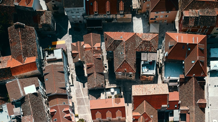 An aerial view of roofs in need of update to increase home value.