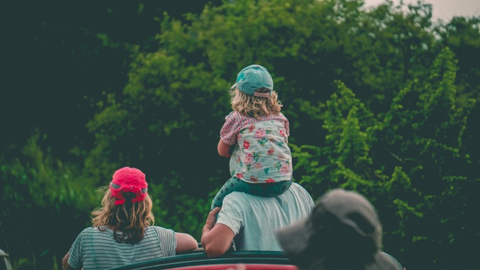 Family enjoying neighborhood near a house in Memphis.