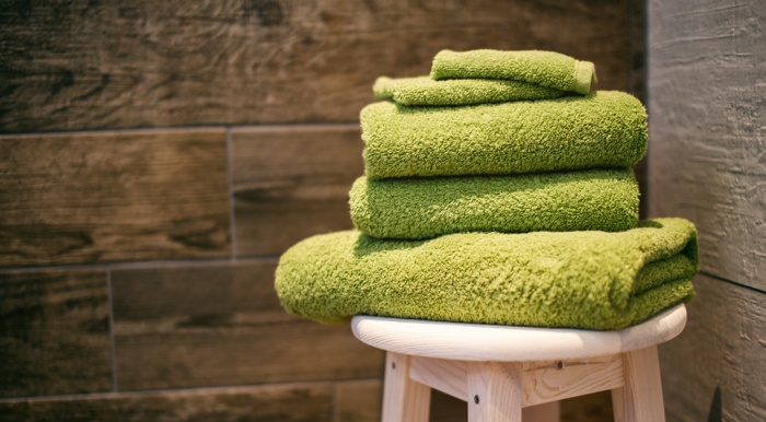 Green towels in bathroom to give soft home staging on lost cost.