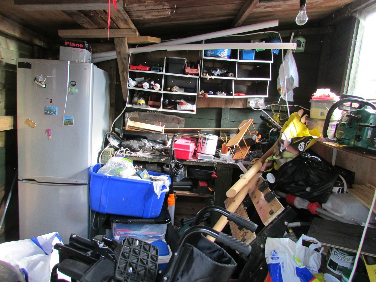 Garage full of stuff in house.