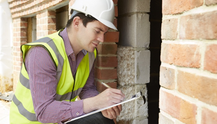 Inspector checking contingencies for real estate offer.