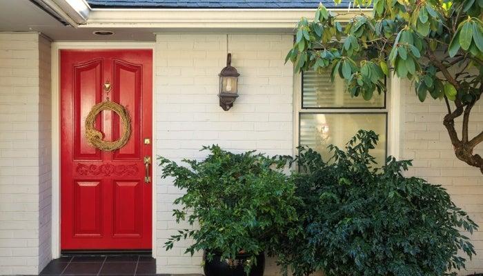 Red front door of house for sale in Cincinnati.