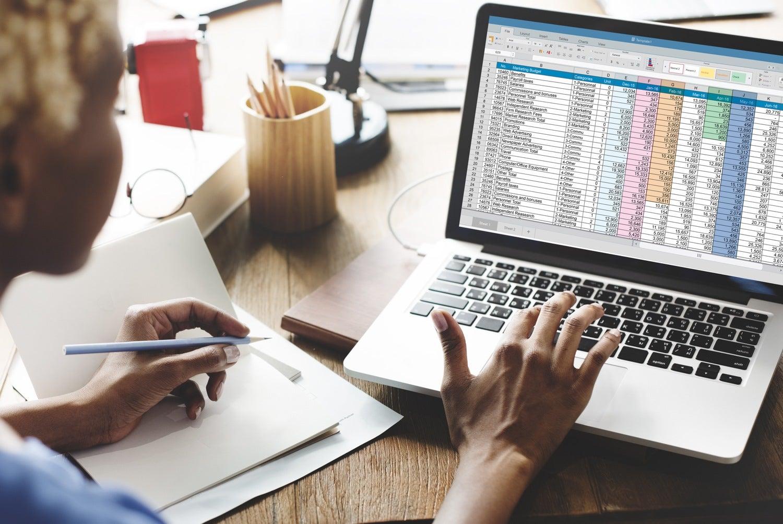 Seller looking over net sheet on computer.