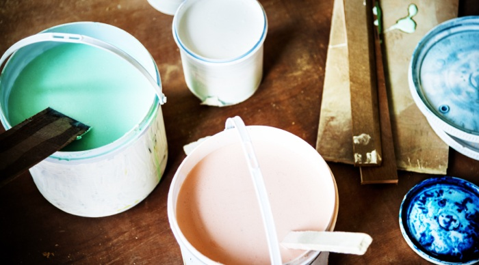 Buckets of paint in home used to increase value.