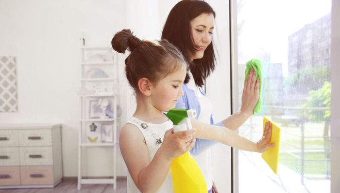 child helping mother with chores after downsizing home with family
