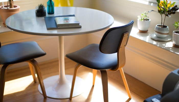 Small kitchen table with two chairs in a downsized home.