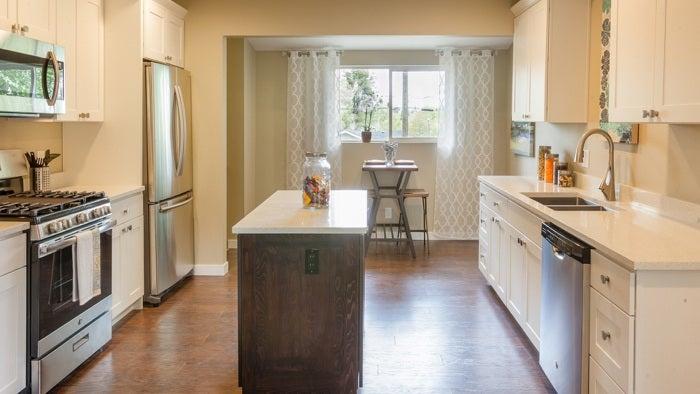 New white kitchen island in house.
