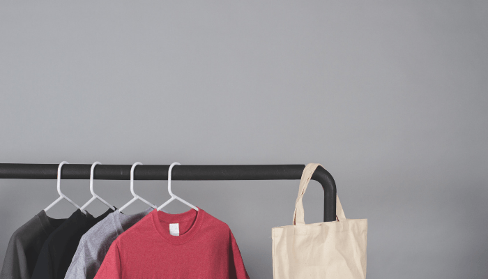 Clothes hanging neatly with help from Marie Kondo.