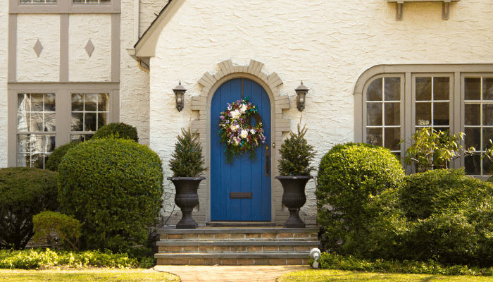 A front door are that has been cleaned and staged outside of a house.