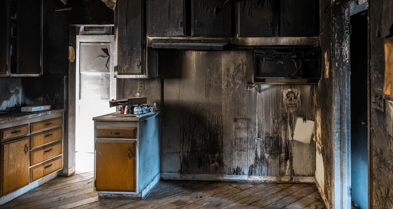 An oven that has had fire damage in a house.