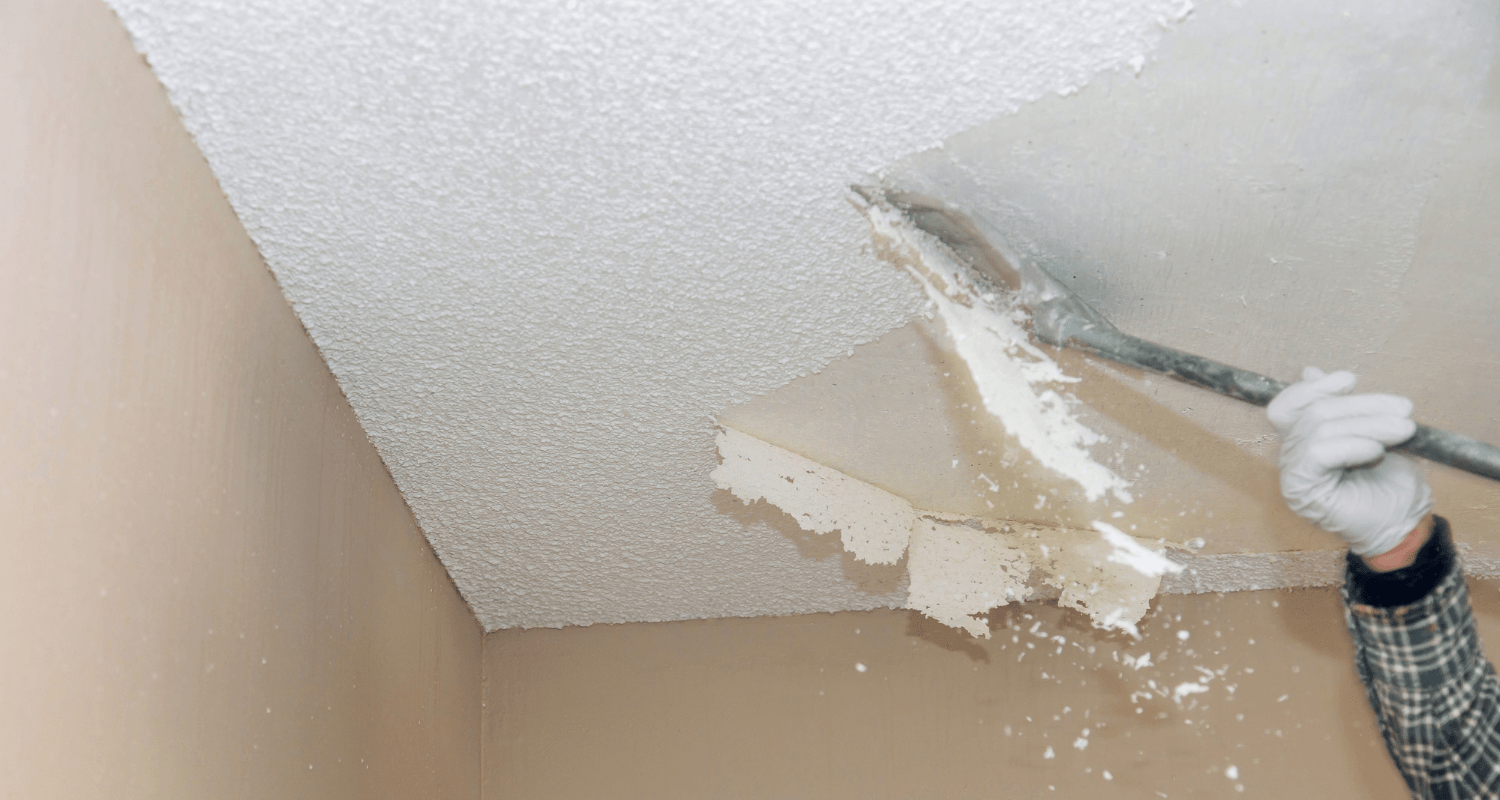A man removing popcorn ceiling to increase home value.