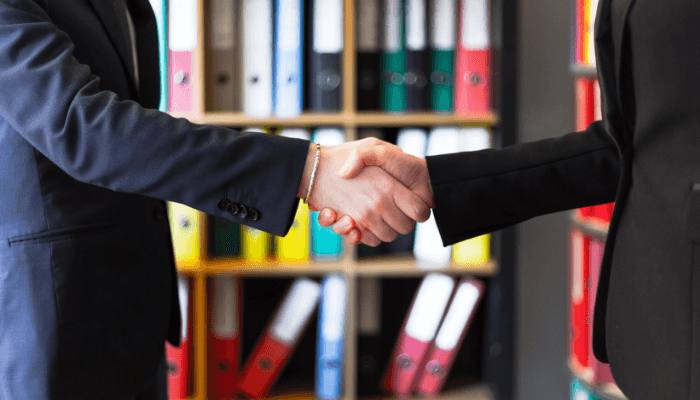 A handshake after agreeing on a home offer.