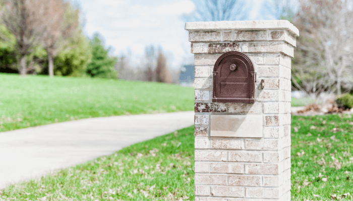 A stone mailbox with curb appeal.