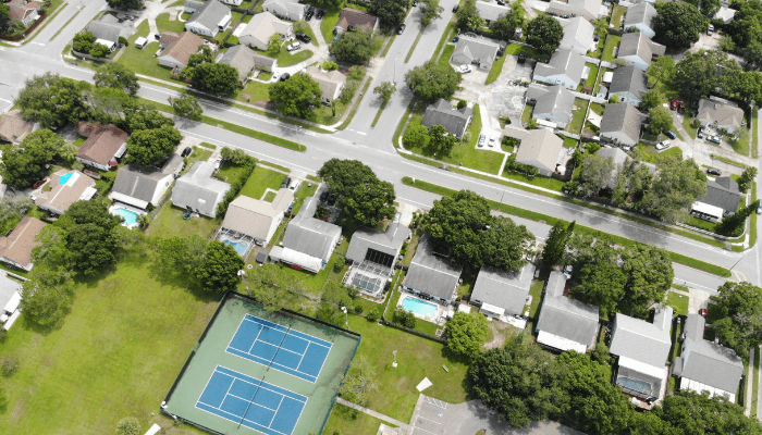 A neighborhood where a property survey is being completed.