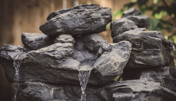 A rock fountain that increases desert curb appeal.