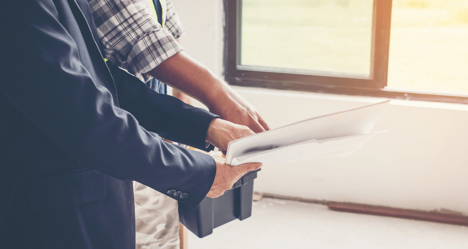A home inspector reviewing types of home inspections.