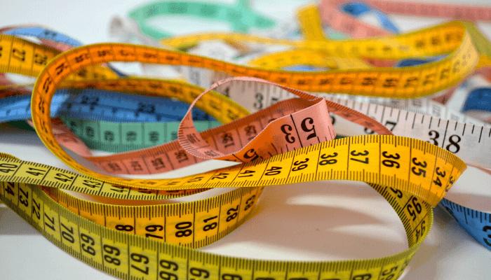 A tape measure used to judge average price per square foot.