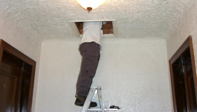 An inspector checking a house you can buy in Sacramento.