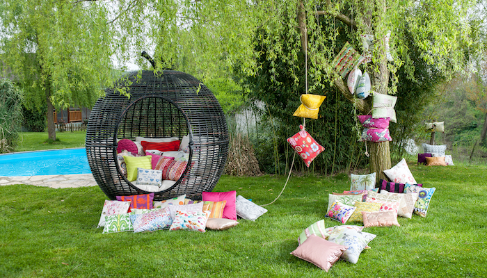 A customized single family home backyard with lanterns and pillows