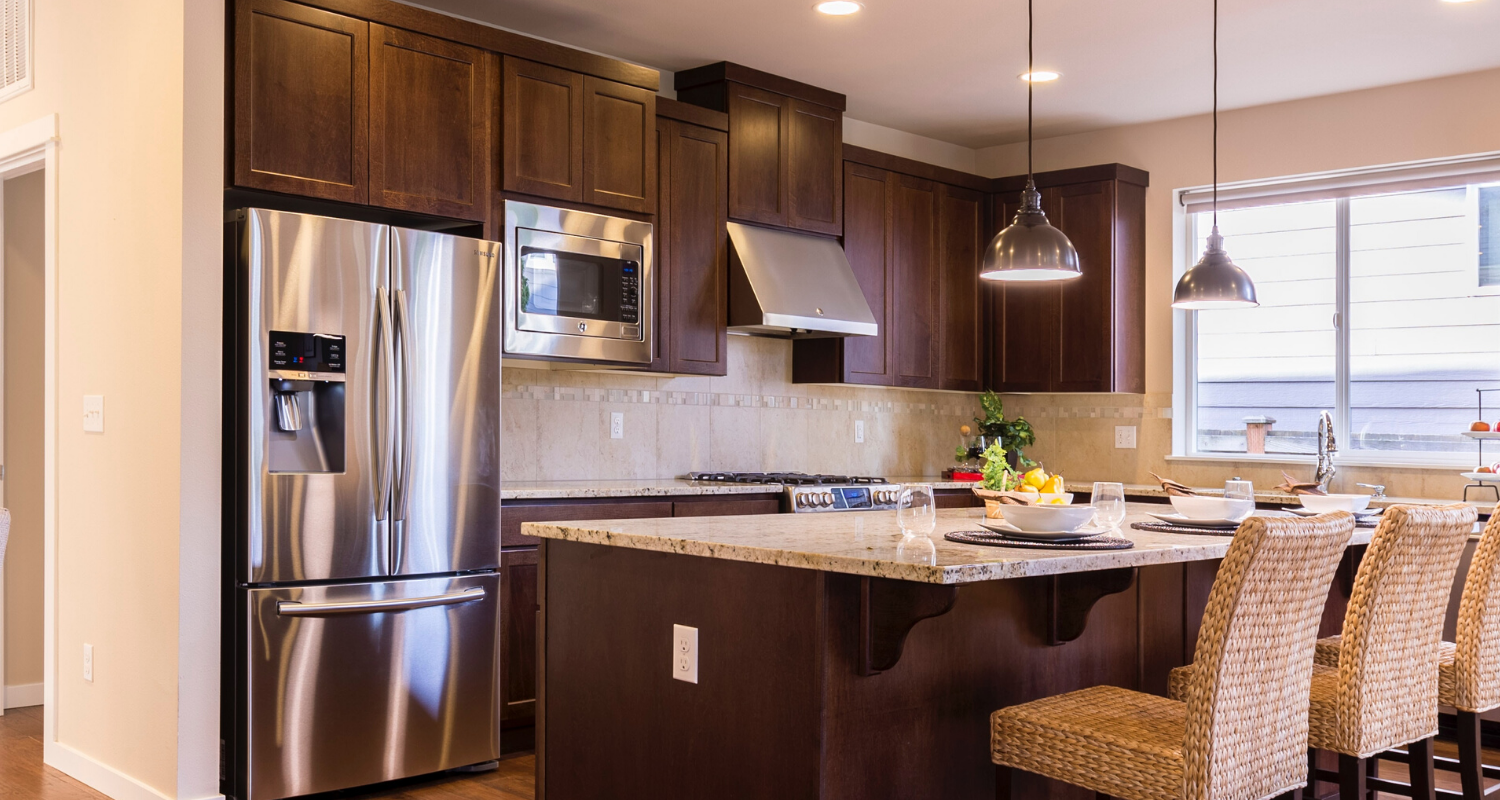 A kitchen with stainless steel appliances in it.