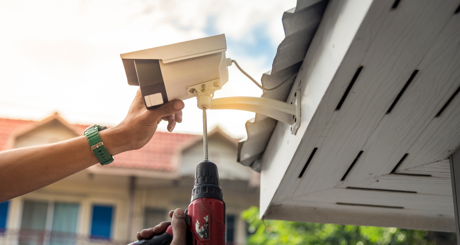 A security system being installed into a home.