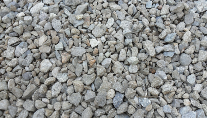 A gravel driveway with curb appeal.