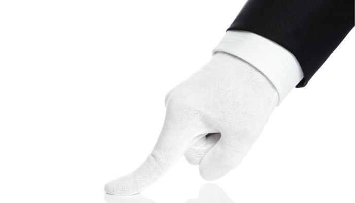 A white gloved hand.