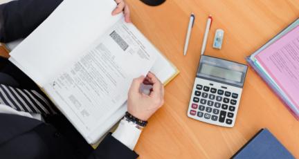 A person calculating price per square foot.