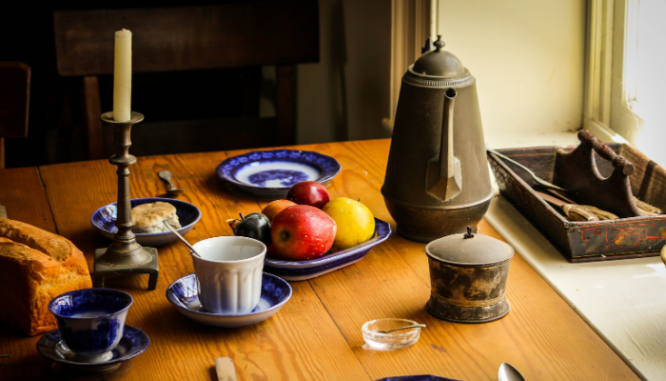A dining room table set for staging a country home.