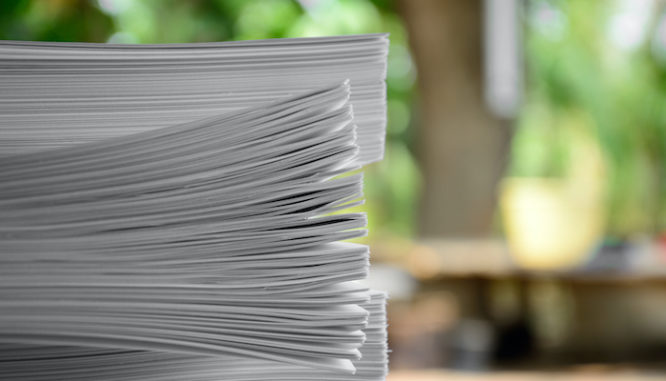 A stack of documents to symbolize getting your documents in order while buying a house during coronavirus