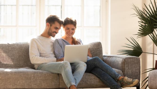 A couple viewing a virtual open house.