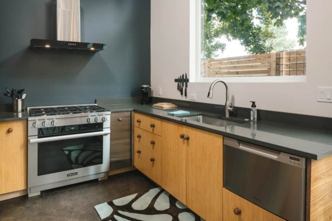 A kitchen with high-end appliances in a mother-in-law suite.