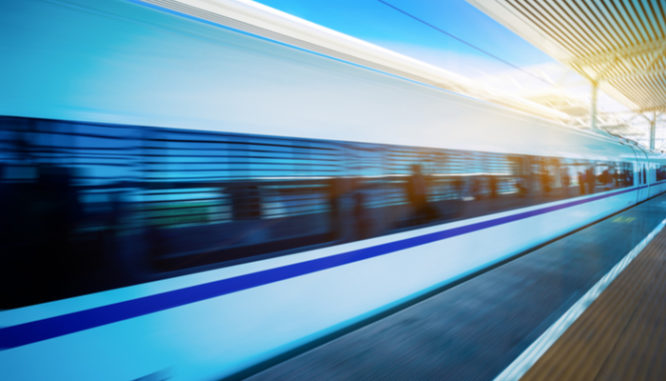 A high-speed train moving through a station symbolizes all cash offer streamlining